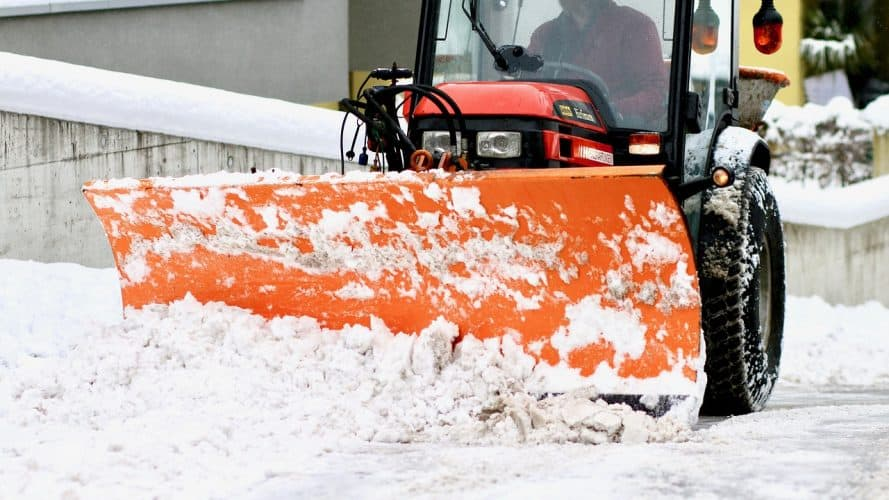 Adding the snow plow to the tractor is part of the winter homestead preparations.