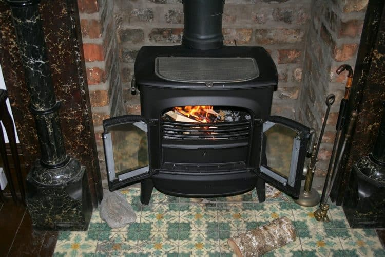 Energy efficiency in the home can be improved by the use of a wood burning stove.