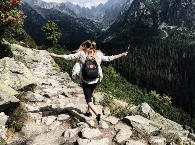 Woman on a mountain top