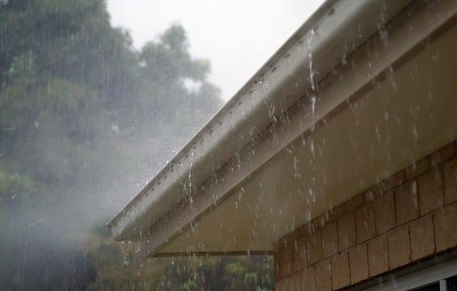 spring rainfall overfilling a gutter