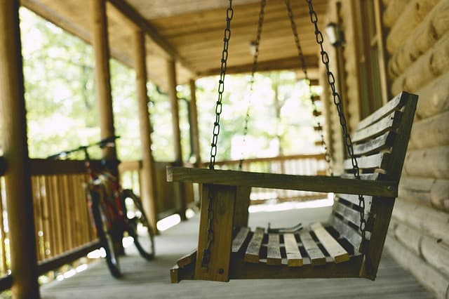 wooden rocker on wooden floored front porch