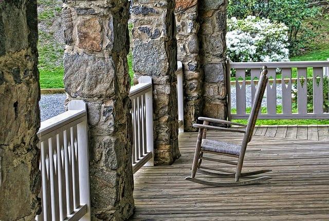 wooden rocking chair on wooden porch floor