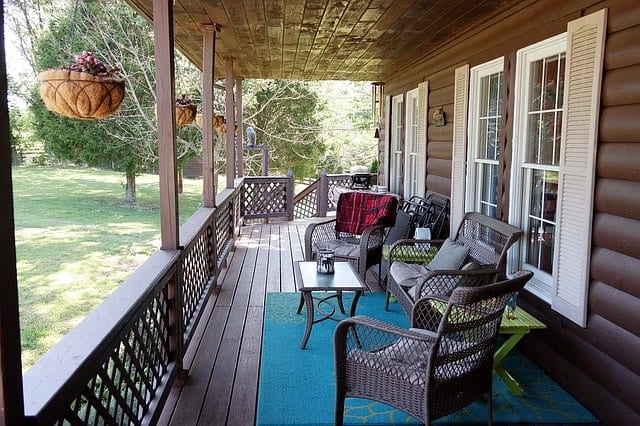 carpet and furniture on log cabin porch