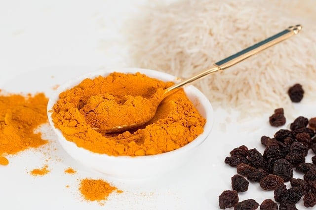 powdered tumeric on a spoon