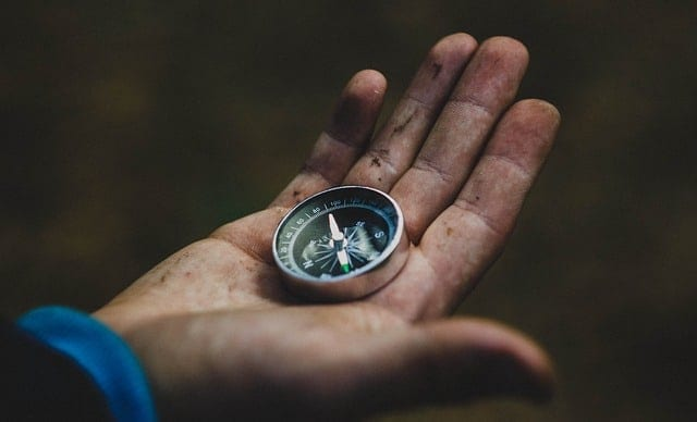 compass in a mans hand