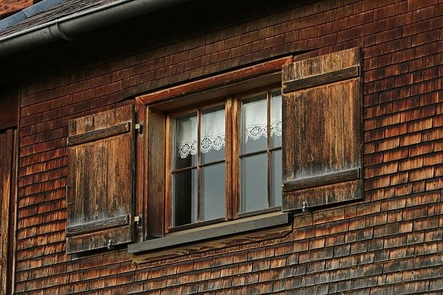 shuttered windows on an old farmhouse