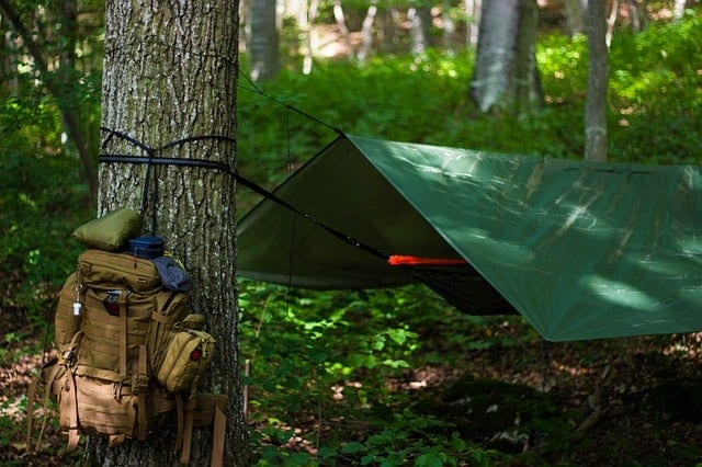 self made tent suspended from a tree