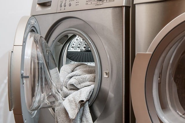 open clothes dryer with towel inside