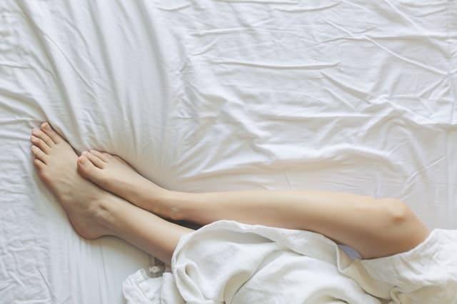 womans feet on a comfortable mattress
