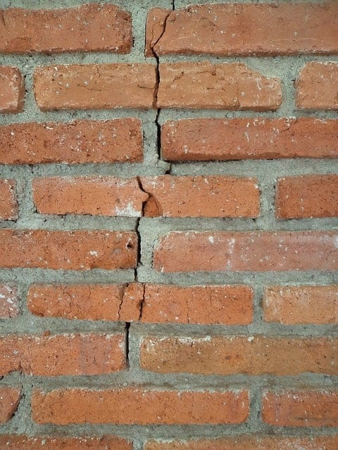 brick wall with crack in it