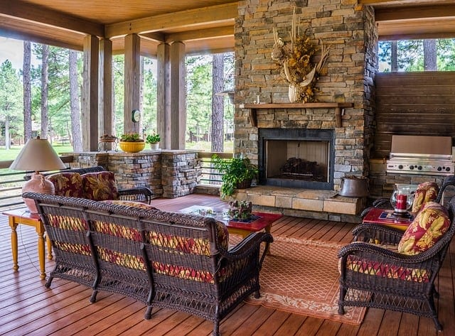 large enclosed porch witha fireplace and seating