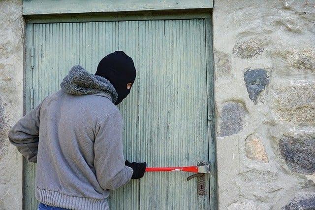 mna breaking into a wooden door