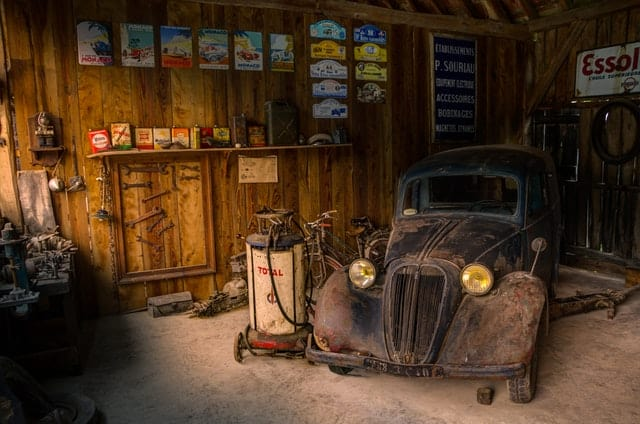Garage with an old antique car parked inside
