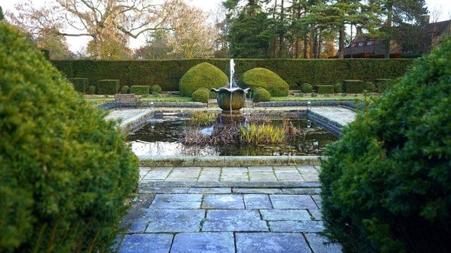 garden fountain in center of landscaping