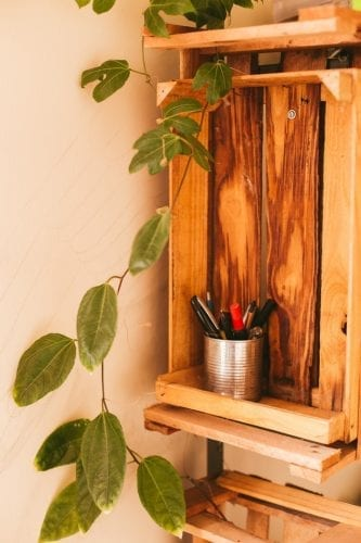 repurposed wooden crate made into a shelf