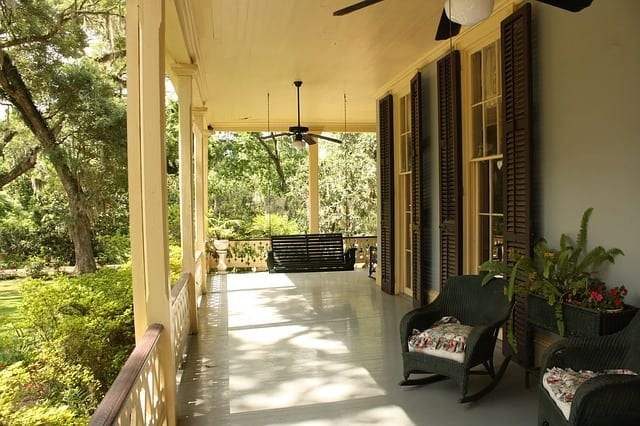 empty front porch with just a rocking chair