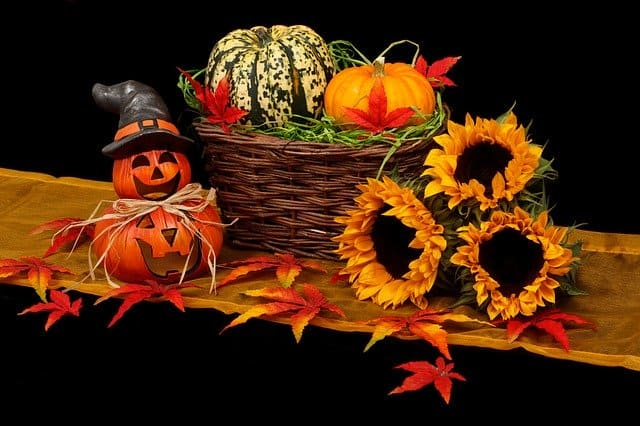 Thanksgiving decorating tips for the home include a cute basket and flowers and gourds.