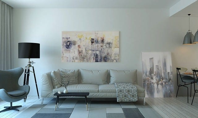 New layout of living room with artwork and a couch.
