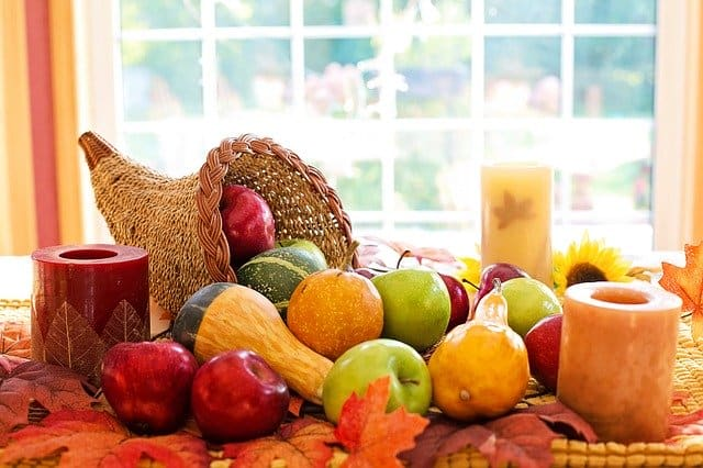 Table setting of fruit and gourds to celebrate Thanksgiving on a budget