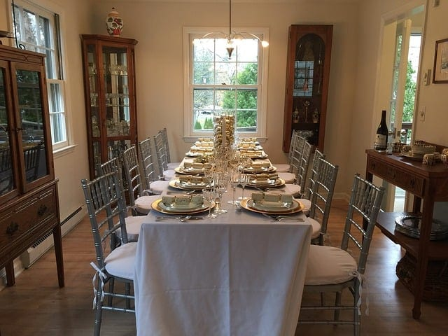 THanksgiving table with fabric for a tablecloth and decorated for Thanksgiving on a budget.