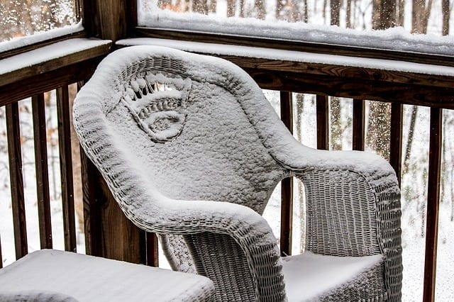 Wicker chair covered in snow
