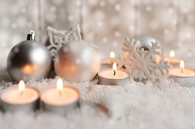 Christmas decorating using ornaments and candles