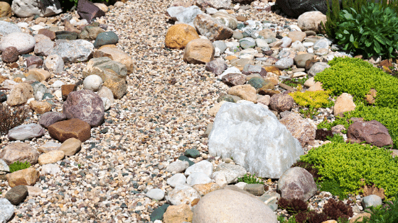 Gravel in a garden bed placed for better drainage