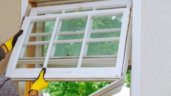 Window installer replacing a broken window.