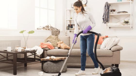 Woman vacuuming carpets