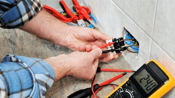 Man replacing an electrical plug