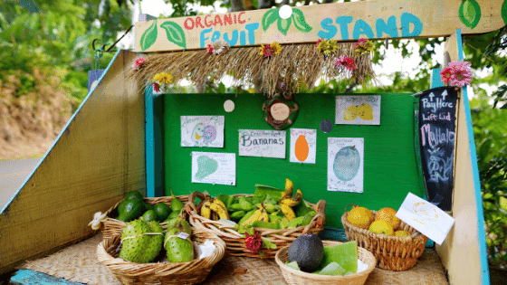 Selling produce at a fruit stand.