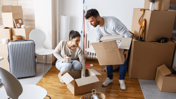 Couple packing up a home