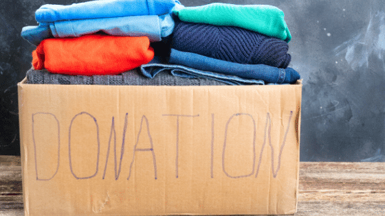 Box of donated clothes for charity