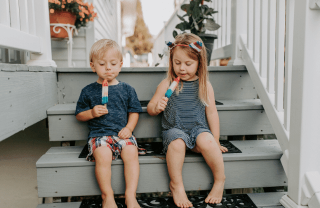 Kids eating popsicles on the stairs