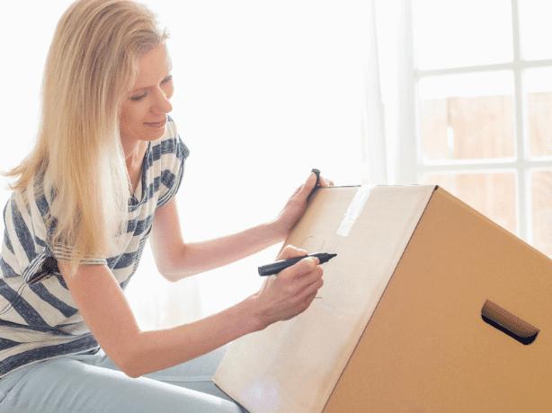 Woman labeling a box