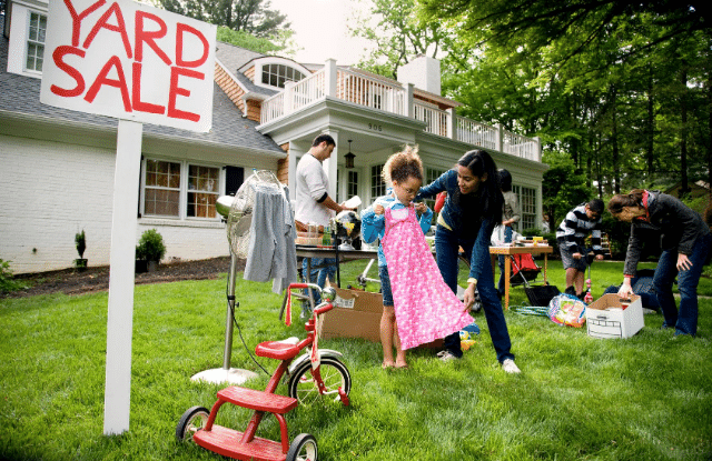 Family having a yard sale before moving to the country