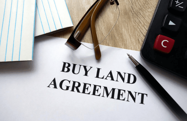 Agreement to buy more land.