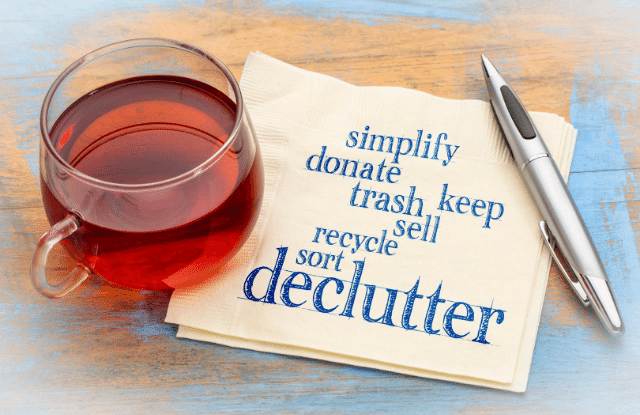 Cup of tea with decluttering words on a knapkin