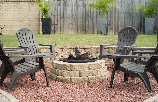 A fire pit is one of the common backyard ideas for making it cozy.
