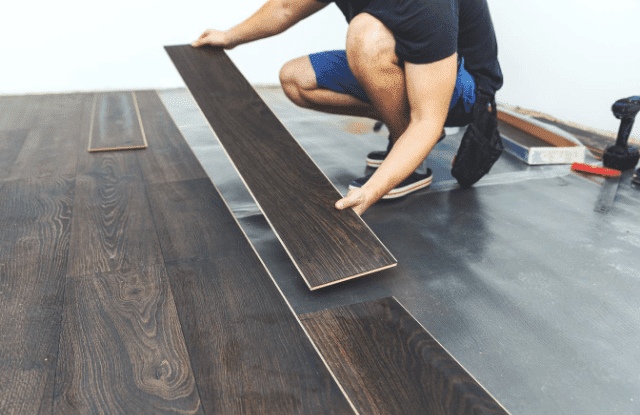 A homeowner doing his own flooring installation.