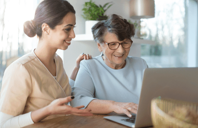 Women searching for design ideas on computer together