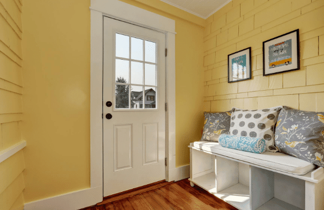 a storage bench in a mudroom