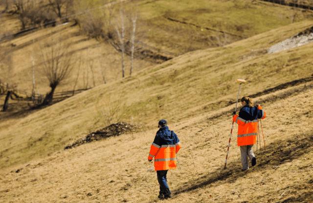 Couple surveying the land before buying