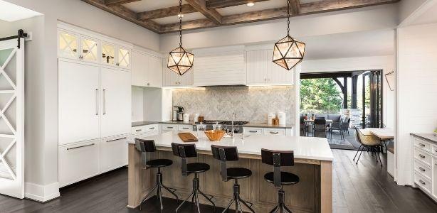 Large, open kitchen with large pendulum type lighting