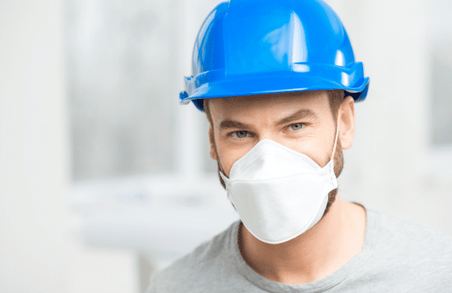 Worker with a mask for safety