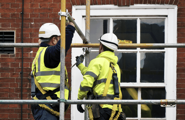Men using scaffolding outside of the home while doing home upgrades