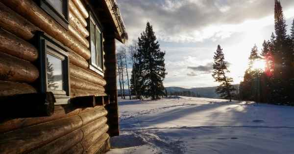 Cabin in the wildnerness of family achieving self-sufficiency
