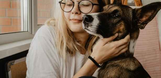 a dog and a woman