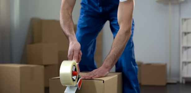 Man packing a box to move