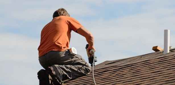 roofer doing roof repairs